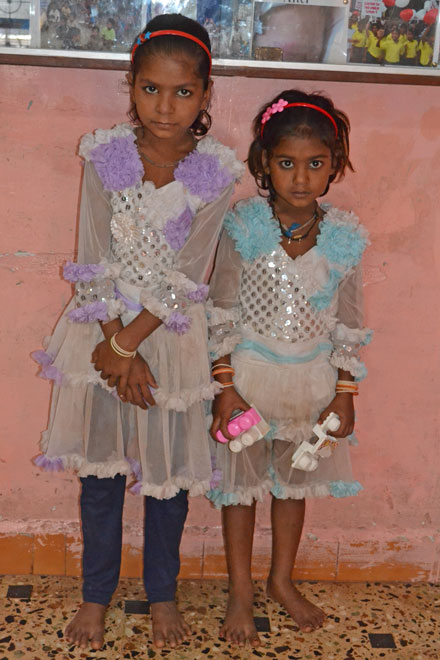 two slum sisters in their party dresses